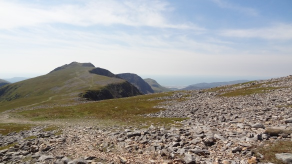 Looking up to Cadair Idris from Mynydd Moel, the Irish Sea in the distance.