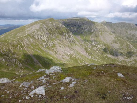 The view towards Helvellyn, centre in the distance, and Nethermost Pike (foreground) from Dollywagon Pike.