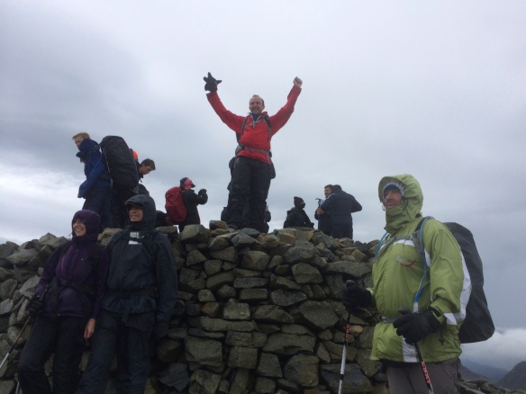 Summit of Scafell Pike (excuse the slightly over the top celebration!), Peter, Margaret and Sener in foreground.