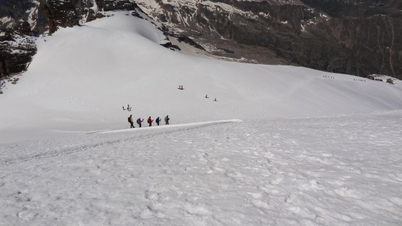 ...and trails of roped up climbers ahead of us meander down the glacier.