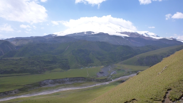 Base camp comes into view at 2,500m on Elbrus - that river down there is also the road however....