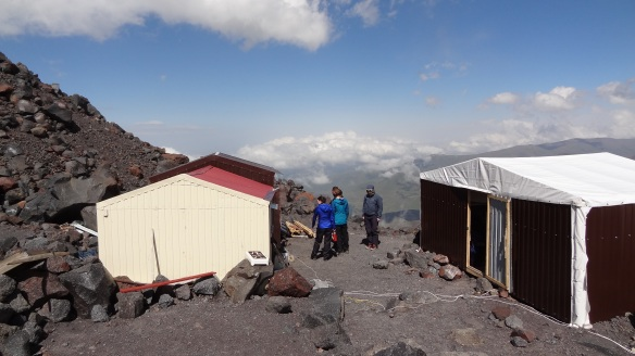 The 'flappy roof' hut on the right, which housed nine of us, the kitchen hut on the left.