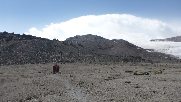 Heading towards the rocks at 3,500m where we would cache our glacier equipment.