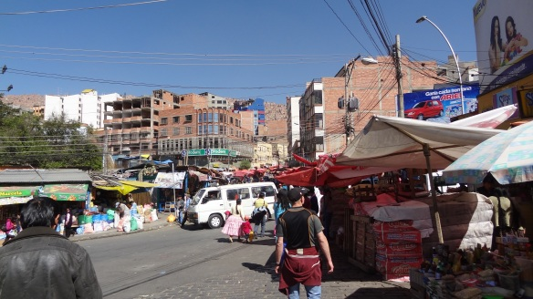 A typical La Paz street market. Note in the background how steeply the houses rise into the hillside.
