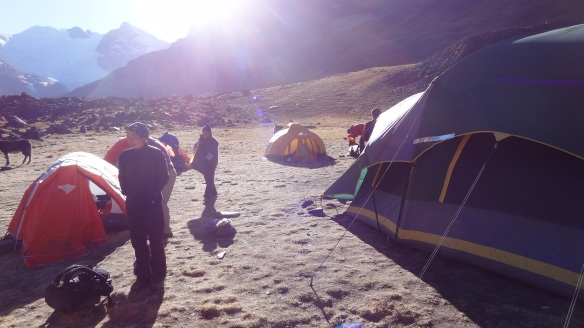 The camp is in a bowl and is flanked by 5,000m peaks and so the sun takes a while to reach it and warm us up a bit.