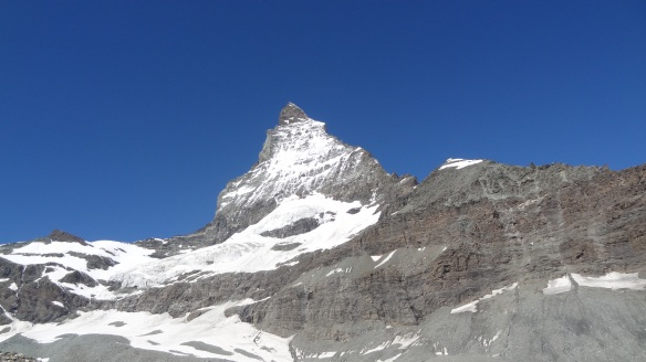 Approaching the Matterhorn - the Hornlihutte is on the tip of snow at about 3pm on the picture.